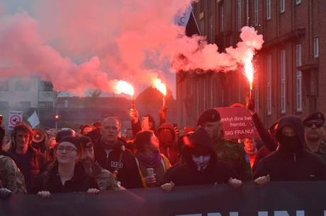 Syv demonstranter blev sigtet, imens en enkelt blev anholdt ved lørdagens Men in Black-demonstration i Aalborg. Foto. Øxenholt Foto